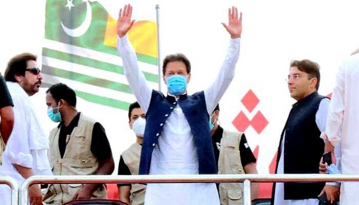 Prime Minister Imran Khan responds to public applause at a gathering in Azad Jammu Kashmir. -APP