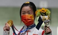 China claim early Olympic golds on day one