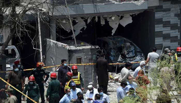 Security officials inspect the site of an explosion that killed at least three people and wounded several others in Lahore on June 23, 2021. Photo: AFP