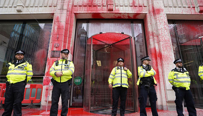 Protesters throw red paint over Guildhal
