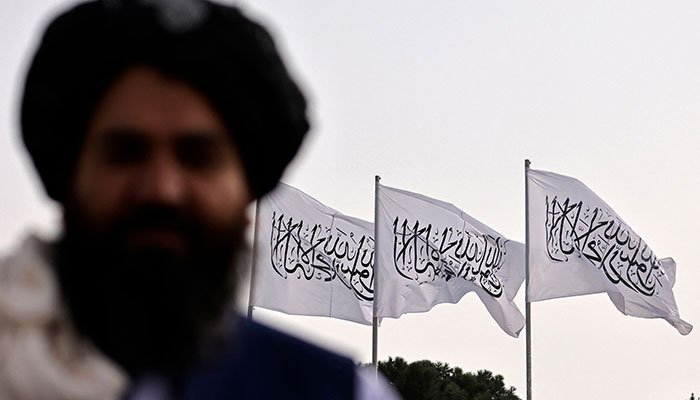 Taliban flag rises over seat of power