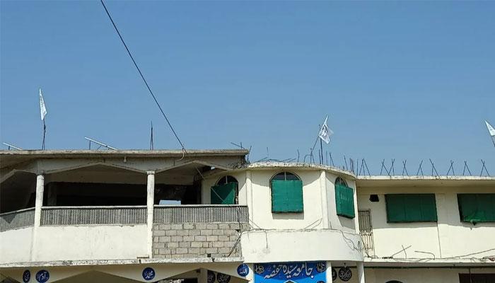 Afghan Taliban flag keeps flying at Jamia Hafsa rooftop