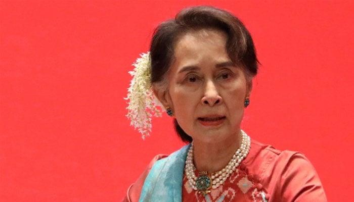 Suu Kyi goes on trial