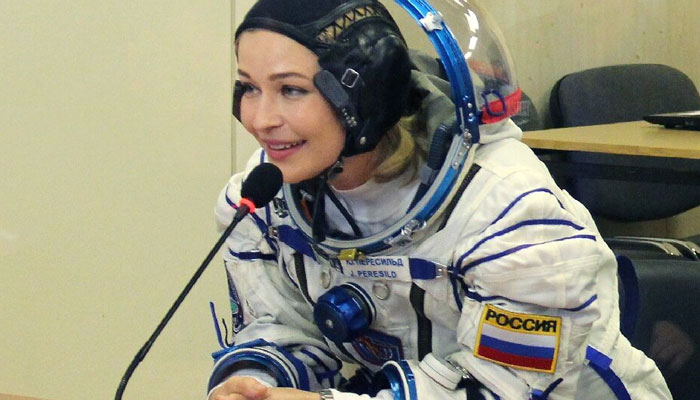 Russian crew docks at ISS to film first movie in space