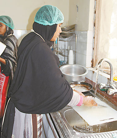 Girls being trained in various household chores