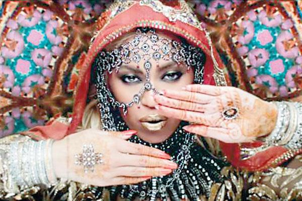 Beyonce wearing Abu Jani Sandeep Khosla in Coldplay 'Hymn For The Weekend'.