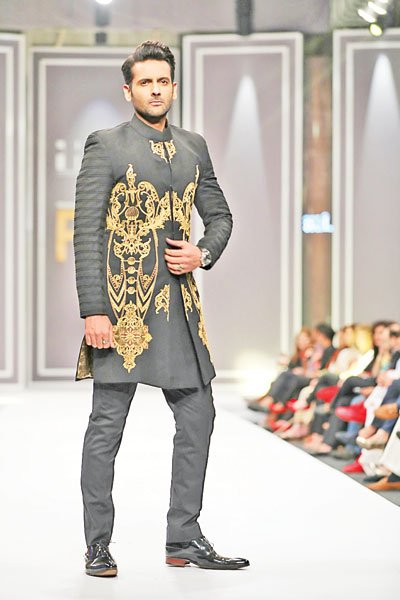 Showstopper: Mohib Mirza walked the ramp for Arsalan Iqbal's black and gold drenched Baroque Star collection.
