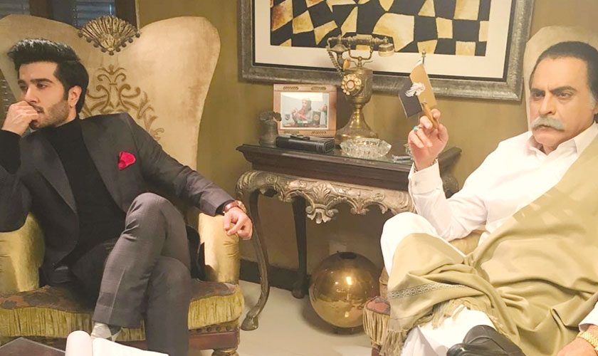 Feroze Khan as Hadi and Mehmood Aslam as his father, who is a politician, in a still from Khaani.