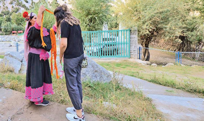 A Kalasha woman welcoming a guest