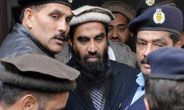Lakhvi behind bars