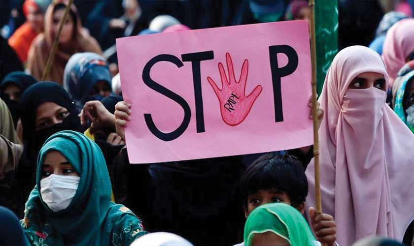 Protestors carrying signs against a gang rape that occurred along Lahore motorway and to condemn violence against women and girls. — Photo courtesy Reuters