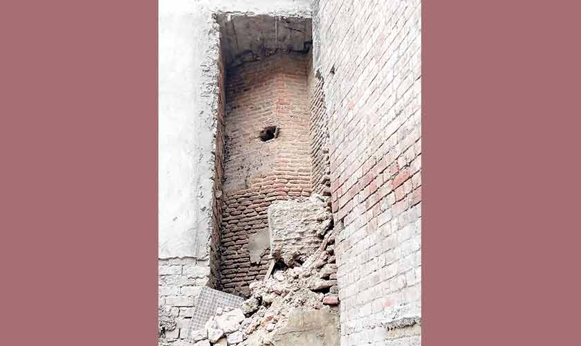 The octagonal tower in ancient bricks, encroached by modern bricks. — Image: Supplied