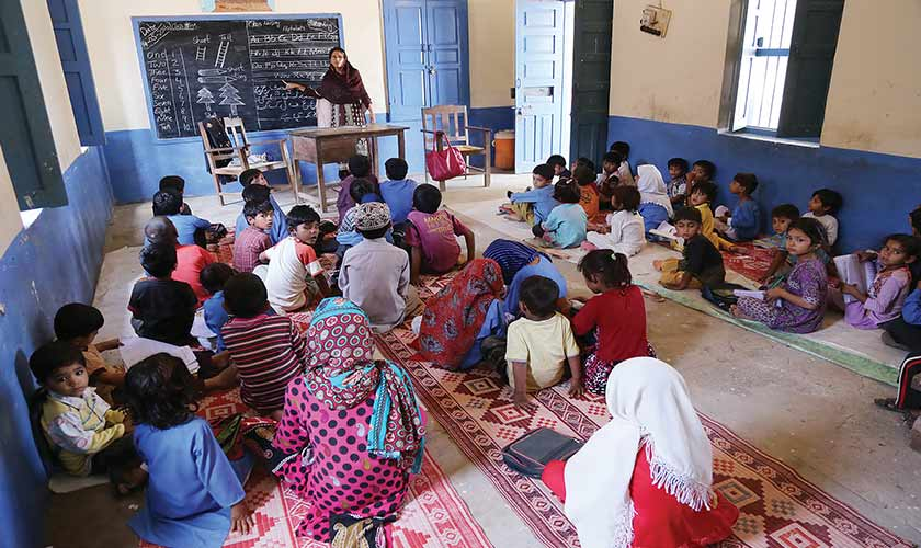 The objective of the SNC is to provide a level-playing field to children from across social strata. However, adding Islamic material to most textbooks could create a disparity. — Photo by Rahat Dar
