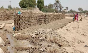 In the midst of  brick kilns