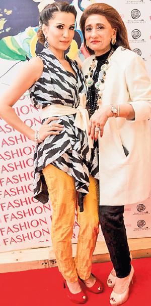 Sadia Siddiqui, CEO of Mustang Productions with designer Nazneen Tariq