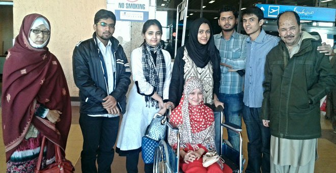 Mehrin and Kauser Ali with volunteers at Karachi airport, returning to Quetta.