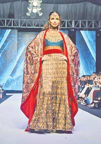 FnkAsia This silk printed cape from FnkAsia's FPW collection titled Folk Spirit is the kind of statement piece that can elevate an outfit from mundane to extraordinary. We love the vibrant red lining and the ethnic tones of the piece that give it a classic yet contemporary feel. Pair it with anything from gold jamavar pants for a wedding or a plain white tank top and jeans combo for a party.