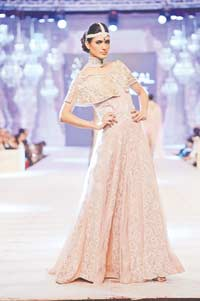 Saira Shakira Add a quirky touch to an embellished outfit with this short, shoulder cape from young designer duo Saira Shakira. The net wrap is intricately embellished with Swarovski crystals and French knots and is a great way to update an old wedding ensemble that you might have relegated to the back of your wardrobe.