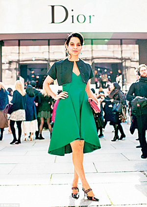 Kangana Ranaut She's one of Bollywood's most fashion-savvy stars and it seems like the rest of the world is realizing it too. Kangana preened like a queen in the front row at Christian Dior and even rubbed shoulders with the label's creative director Raf Simmons post-show. There is so much to love and take back form her look - the asymmetrical hemline would elevate a summer tunic from plain to trendy; the emerald colour, or a similar jewel-toned shade, would stand out in a crowd of prints and the bright pink bag shows us how a pop of colour can look great with any outfit.