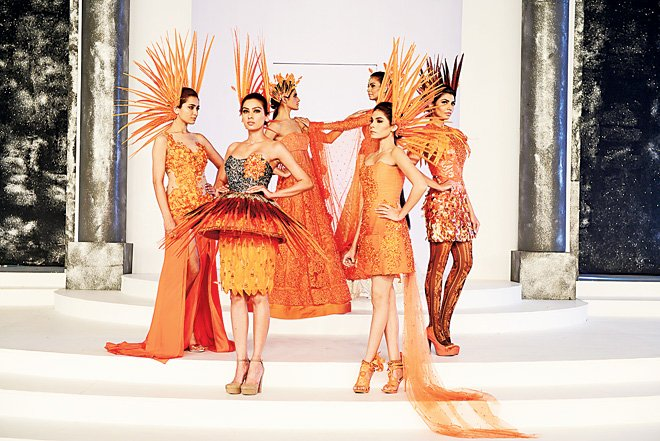 Nomi Ansari's tangerine collection featuring dramatic headgear managed to up the expected drama whereas Khadija Shah (Elan) chose the classic route to restrained elegance.