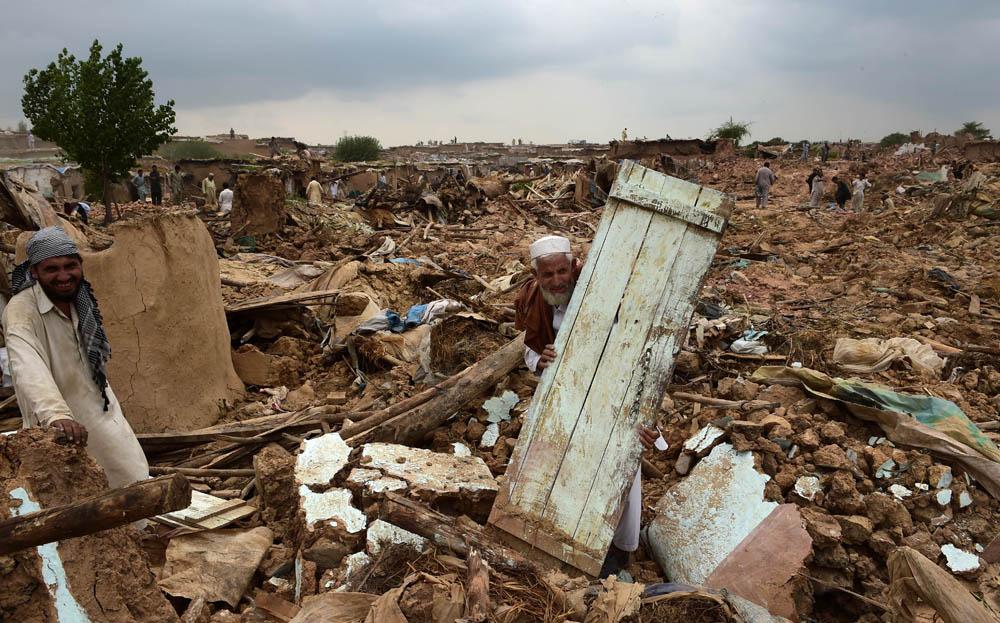 It took three days to raze the entire basti. --Photo by Farooq Naeem / AFP