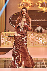 Shehla Chatoor went down theliteral route to emblazon her luxurious gowns with Magnum bars; it was a tongue in cheek approach to luxury and it worked. The opening gown, constructed in a wrapper print set the mood for the evening and it screamed out one simple message: why must fashion always take itself so seriously? Time to have fun with it.