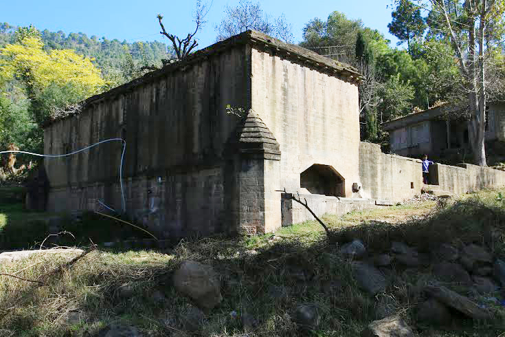 The exterior of the building. Notice the buttressing structure with the corbelled top.