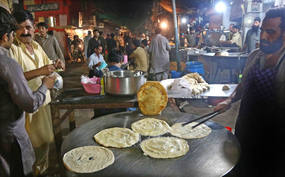 Peshawari kehwa was being sipped at the shops, and Kashmiri kulchas were being spun at the roadside ovens.