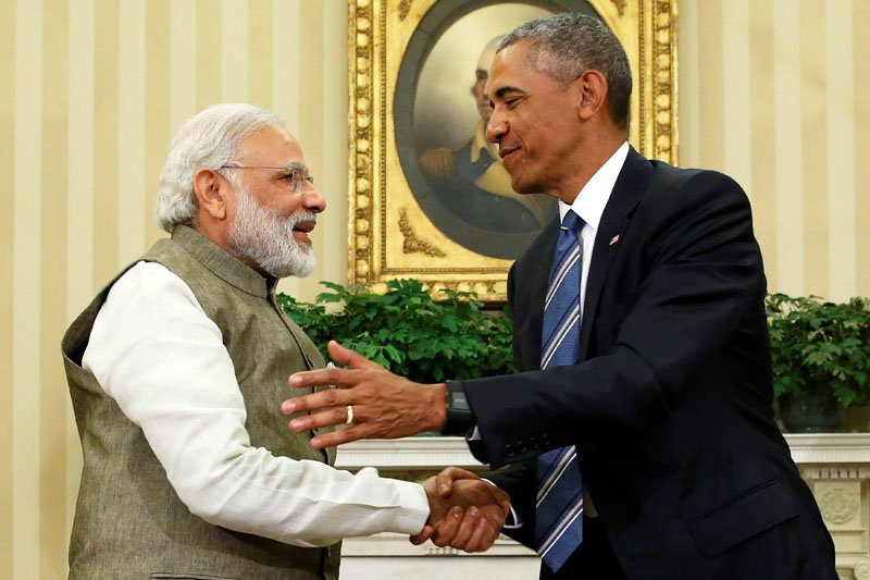 Obama (R) shakes hands with India's PM Modi. -- Courtesy Reuters