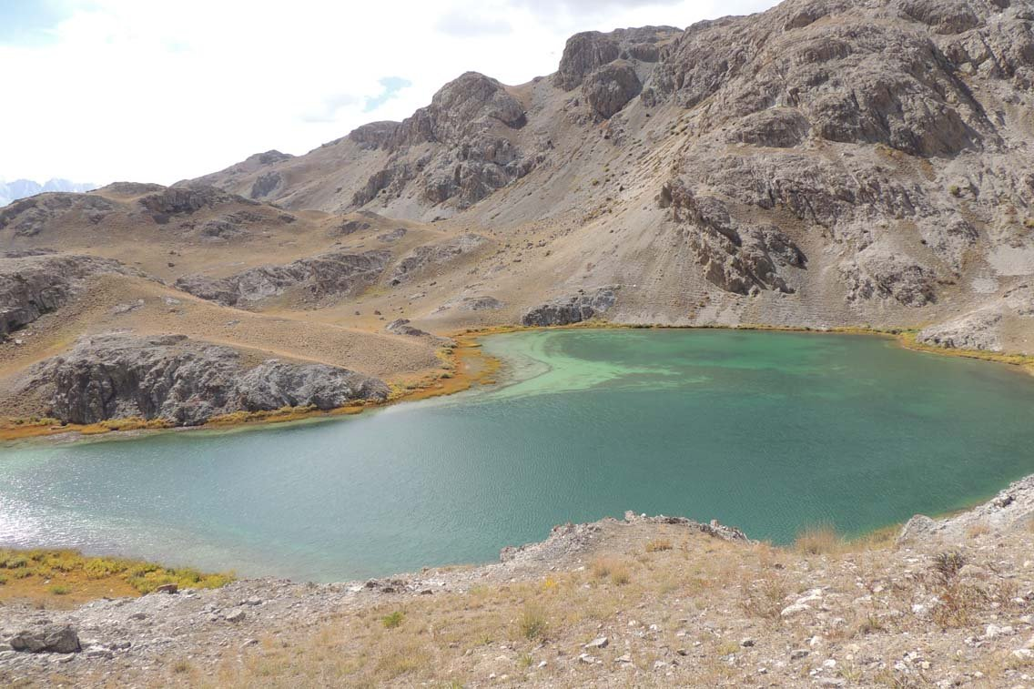 A small lake lodged neatly between hills.