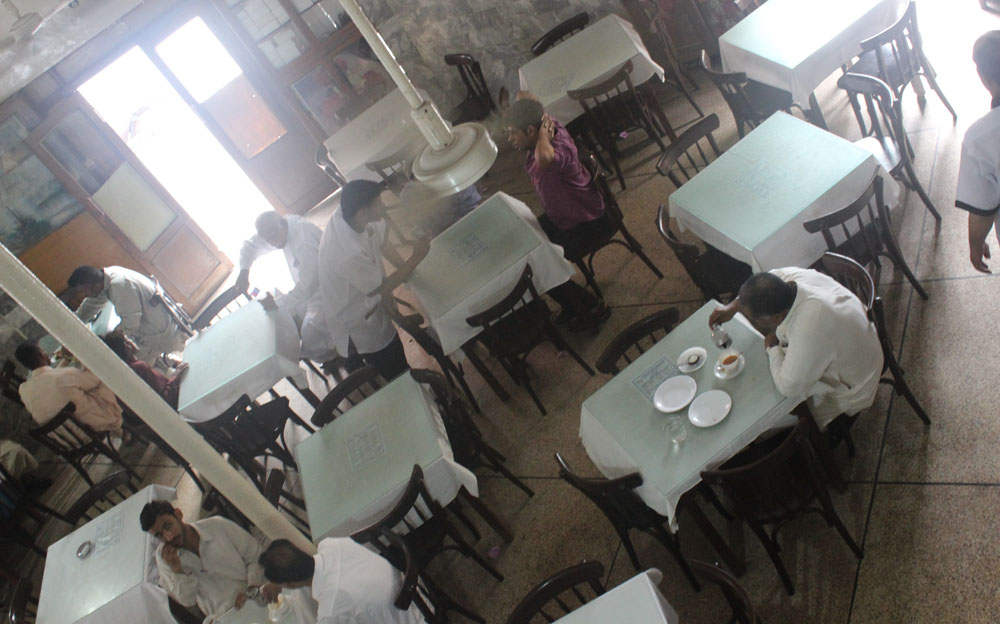 Diners enjoying their food and socialising at the café.