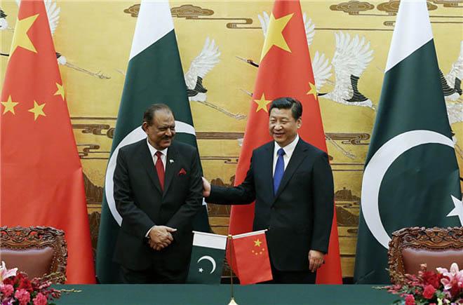Mamoon Hussain with Xi Jinping.