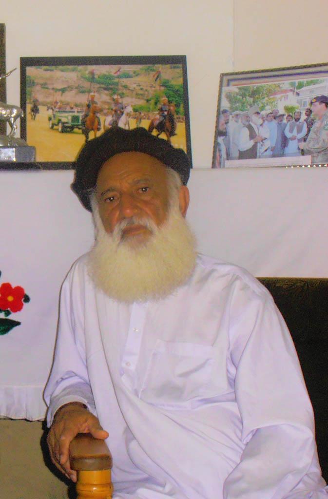 Khursheed Ali at his residence at Darosh.  Framed photographs of Col Murad hanging on the walls.