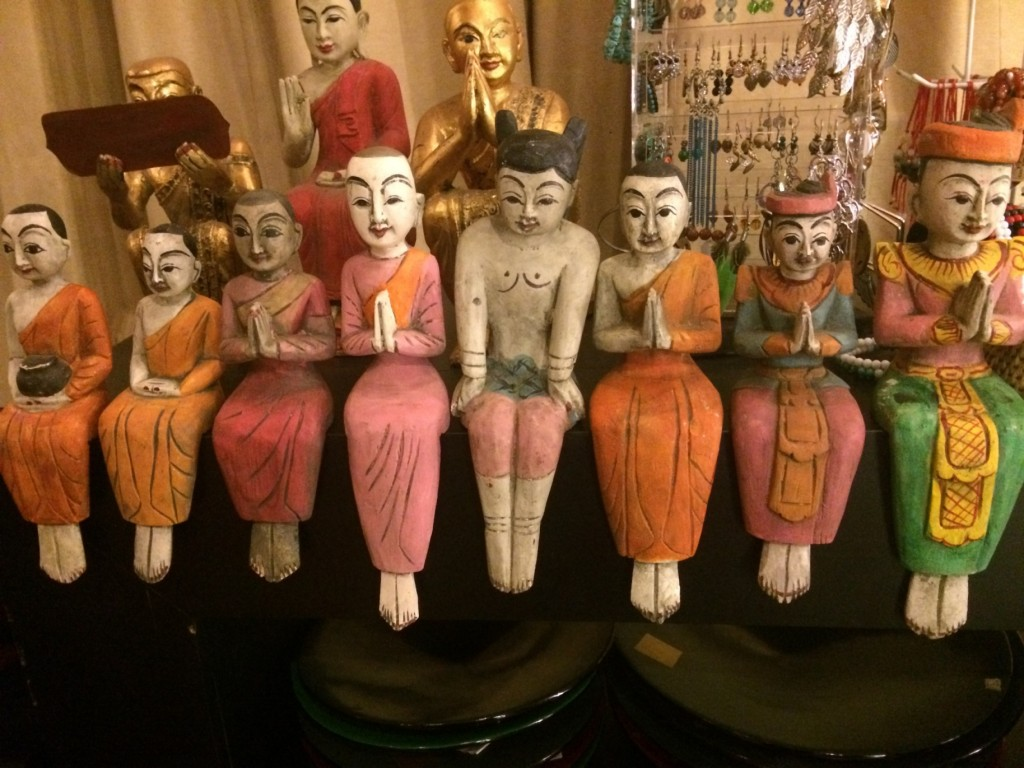 Handmade wooden statuettes of monks and pilgrims on sale.