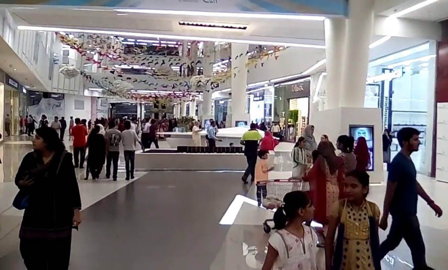 The many upscale shopping malls often have people come in and sit around just to use the free wifi connection in free air conditioning.
