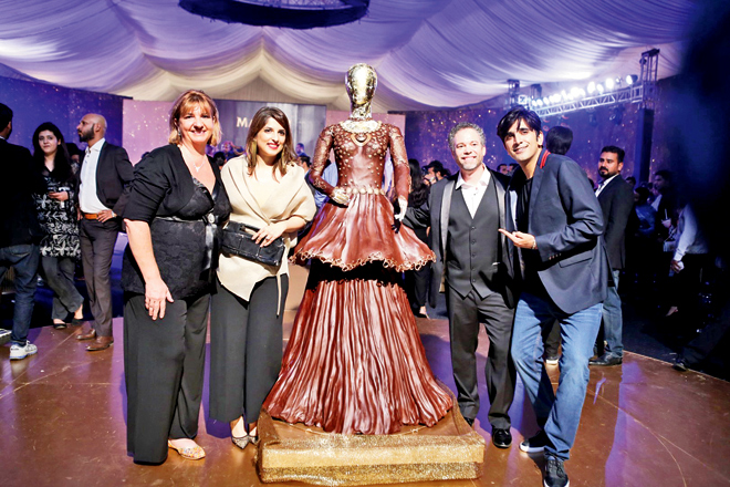 Chocolatier Paul Joachim created this dress with Ali Xeeshan (not in picture) and got everyone excited, as is evident by Ali Hamza's expression. We wonder if the dress was consumed at the end of the night!