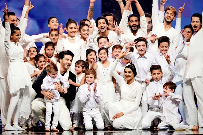 Ahsan Khan and Amna Ilyas presented a dance act on A.R. Rahman's Gurus of Peace and were joined onstage by a group of children. Choreographed by Wahab Shah, it was quite a befitting opening to the event.