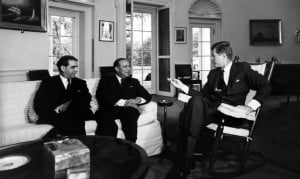 John F. Kennedy (right, in rocking chair) meets with Pakistani Foreign Minister M. Ali Bogra (centre) and Ambassador Aziz Ahmed (left) at the White House.