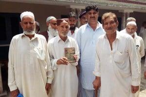Roshan Mistri's family holding the book.