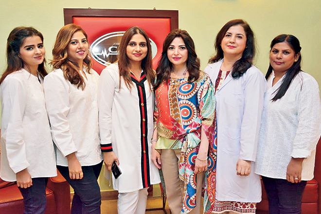 Farkhanda Bawany (centre) and her team of trained professionals at the CACI Centre in Karachi.