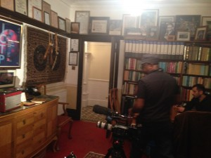 Anand Kamalkar and Omar Vandal (background) filming in Salam's house in Putney.