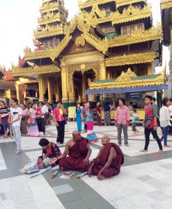 Monks and other Buddhist devotees in the vast courtyard of the Shwedagon Pagoda in Yangon.