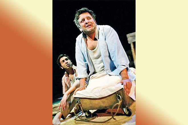 Rehan Sheikh onstage performing during A Fine Balance, an adaptation of Rohinton Mistry's novel at Hampstead Theatre in 2005.