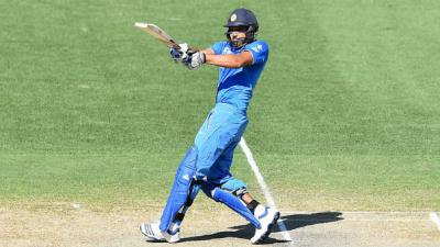 Sharma hits century in timely win for India