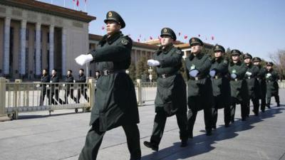 China defence budget rise to defy slowing economy