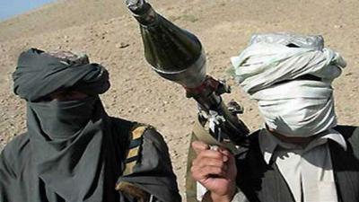 Militants kill at least 13 Afghan police despite peace talks