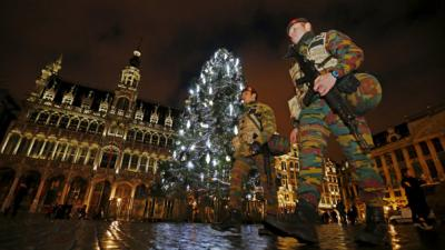 Brussels reviews security alert, hunts 'several' suspects