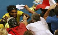 Serena beats Sharapova to reach semi-finals