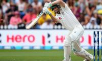 Voges cashes in as Australia forge huge lead