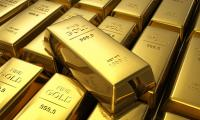 Gold poised for best week in eight on dollar slump